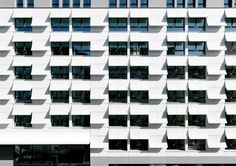 covered in leafy 'pages' of formed fiberglass reinforced concrete, the exterior at the eurostars book hotel in munich creates an illusion of a windblown manuscript. Retail Facade, Mixed Grill, System Architecture, Details Magazine, Concrete Facade, Reinforced Concrete, Facade Design, Book Pages, Learning Centers