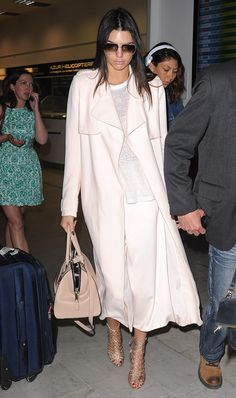 Kendall Jenner looks flawless even after a long flight! Camilla and Marc coat and pants; Sophia Webster shoes