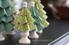 """Today's installment of """"Landee's Festival of Trees"""" comes directly from Martha Stewart's latest publication Handmade Holiday Crafts. I LOVE this book. Love it. These trees were so dang cute I just had to give them a try!! Supplies needed: cardstock of choice, bamboo skewers, wood candlestick holders (shown below), wooden finials (shown below), hot …"""
