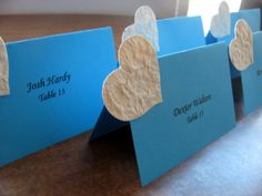 This listing includes 5 sample personalized turquoise cardstock tent style placemarkers with ivory plantable heart shaped accents (pictured here) that are