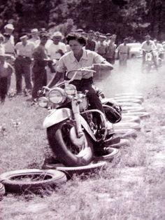 Tough vintage lady rider showing her stuff while taking on a really tough obstacle run back in the day.