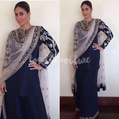 In true begum style Kareena Kapoor Khan attended a jewellery store opening in Hyderabad wearing a navy blue embroidered sharara suit by Payal Singhal. Styled by Tanya Ghavri  slicked back hair, barely there makeup, she had everyones attention.