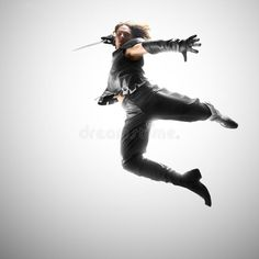 Photo about Man jumping with a sword in a suit of the warrior. Image of actions, adult, exercising - 62569046 Photo about Man jumping with a sword in a suit of the warrior. Image of actions, adult, exercising - 62569046 Sitting Pose Reference, Action Pose Reference, Human Poses Reference, Pose Reference Photo, Sword Reference, Anatomy Reference, Reference Images, Art Poses, Drawing Poses