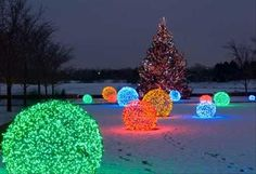 Bright Christmas light orbs - like the oversize effect they give, maybe have outside on the grass? or lining hallways or stage?