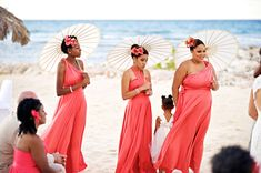 beautiful beach bridesmaids in coral, with parasols.  photo by Saab Wedding.