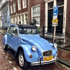 Such a pretty sight a 2CV parked in the street...