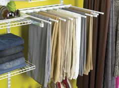 Slide out pants rack for use with the Configurations or Home Free closet organization system....