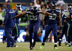 JANUARY 19: Defensive end Cliff Avril #56 of the Seattle Seahawks celebrates in…