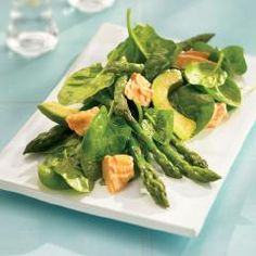 Salmon Spinach Salad with Sesame Dressing:  Pink flakes of rich salmon are beautiful against sesame-dressed green spinach. A great dish for entertaining. A source of iron and Omega-3.