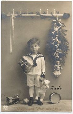 Old Christmas card with boy in sailor suit