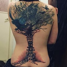 Intricate Skeletal Spine Tree and Raven Tattoo in Dark Colours