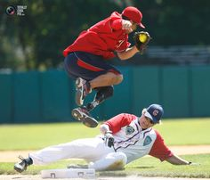 Wounded Warrior Amputee Softball Team 3B Saul Bosquez leaps in Cooperstown