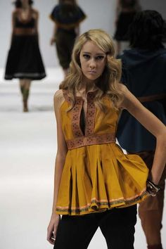 Sami inspired fashion;  Yellow top with pleats, reindeer leather