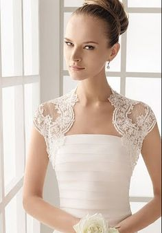pretty bolero. Love how the lace curves in at the neckline.