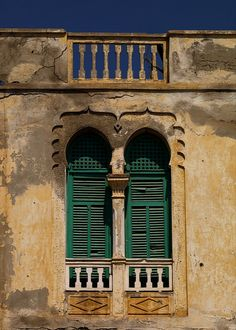 Turkish window, Massawa, Eritrea | Massawa, also known as Mitsiwa or Massaoua is a port city on the Red Sea coast of Eritrea, important for many centuries, it has been colonised by Egypt, the turkish Ottoman Empire, Italy, England and was finally part of Ethiopia until the independence of Eritrea in 1991 after a long war, the old town is still full of old houses, but many are in ruins (Eric Lafforgue)