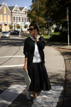 4365013a0dd6e0 Pleated skirts are a trend that s quickly become a closet staple. Here are  outfit ideas and inspiration for how to style a pleated skirt.