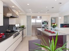 The open floor plan in this modern kitchen makes it a great place for cooking and entertaining guests.