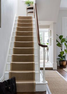Interior Design by Imperfect Interiors at this Georgian terraced house in London. A palette of calm Farrow & Ball paint colours mixed with t. White Staircase, House Staircase, Staircase Design, Grand Staircase, Staircase With Runner, Sisal Stair Runner, Staircase Ideas, Stair Runners, Stairs With Carpet Runner