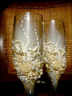 Hand decorated wedding champagne glasses, elegant toasting flutes in ivory and white. $54.00, via Etsy.