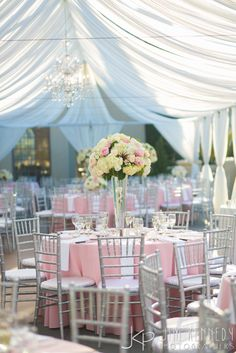 Outdoor tented reception at this Marbella Country Club wedding | pink and white tent reception | Jim Kennedy Photographers