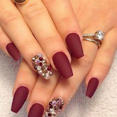 Fall is here! Let your nails be the center of attention with this look. Ruby red with a crystal accented nail is elegant for any occasion.