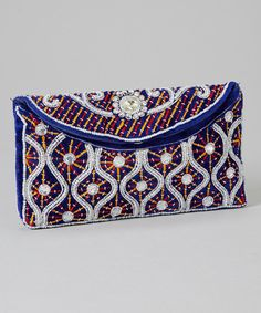 This+sleek+clutch+is+full+of+statement+style+thanks+to+its+vibrant+embroidery!+The+sleek+space+acts+as+ample+storage+for+fashionable+essentials.