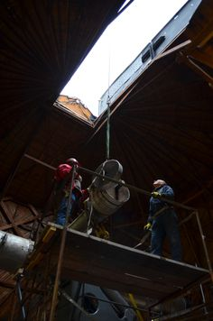 January 28, 2014 - The second counterweight is lifted out of the Clark Telescope dome.