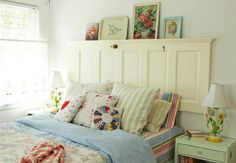<3 Simple and cute. And you can always find old doors at Habitat for Humanity! A set of bi-fold doors would work great too. And you can hang pics from the slats.
