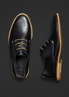 he by mango. black leather uppers with wood sole.