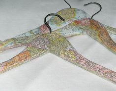 Map covered clothes hanger. If you had a vintage or antique piece of clothing that you would like to display then hanging it on a clothes hanger that shows the country or area the piece came from could be interesting.