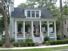 Carolina style front porch, with railing and piers and lattice.
