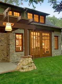 An Arts & Crafts Cottage Preserved: This makeover of a Pasadena cottage, built and rebuilt on an old stone foundation, kept its original character. The copper and art-glass lantern is perfect for the rustic stone cottage.