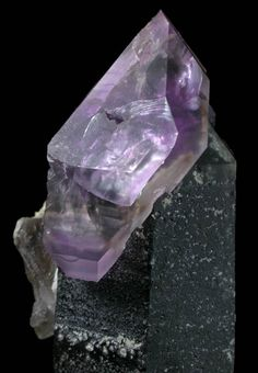 Quartz (Amethyst-Smoky Scepter Crystal). Location of mineral deposit: Little Gem Mine, Upper Rader Creek, Jefferson County, Montana. Description: Large scepter formation of a transparent dark-smoky quartz crystal 70 mm long with a larger 40 mm cap of a transparent purple amethyst crystal.