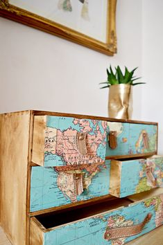 Ikea Moppe hack with maps and leather drawer pulls. Ikea Moppe hack with maps and leather drawer pulls. Great look for those with w… Ikea Moppe hack with maps and leather drawer pulls. Great look for those with wanderlust. Repurposed Furniture, Painted Furniture, Refurbished Furniture, Diy Furniture Upcycle, Vintage Furniture, Vintage Chairs, Diy Tapete, Leather Drawer Pulls, Map Crafts