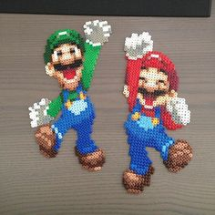 Luigi and Mario perler beads Melty Bead Patterns, Pearler Bead Patterns, Perler Patterns, Pearler Beads, Beading Patterns, Pixel Beads, Fuse Beads, Mario Crafts, Perler Bead Mario