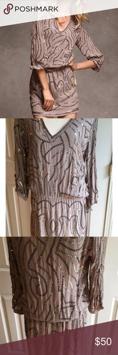 Victoria's Secret sequined blouson dress Mona International by Victoria's Secret sequined dress. Tag has been cut to prevent store returns. -100% viscose -bodice fully lined -elastic waist -3/4 sleeve -v-neck -pull over style -beige/taupe color. Victoria's Secret Dresses