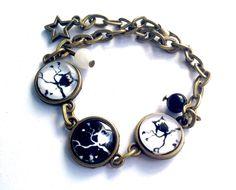 Bracelet cabochon hibou noir et blanc, retro vintage fantaisie, en bronze, perles et étoile. : Bracelet par thislia