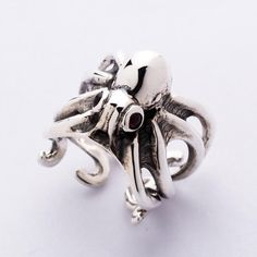 Sterling Silver Octopus Ring is crafted with attitude. Thanks to shiny silver and Original Style ✔ Red Garnet Eyes Inlaid ✔ Adjustable Size Ring. Silver Skull Ring, Mens Silver Rings, Silver Man, Sterling Silver Jewelry, Skull Rings, Mens Rings For Sale, Rings For Men, Octopus Ring, Gothic Rings