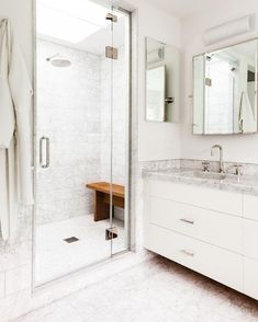 The Carrara Marble Countertops and White Interior Design give this Master Bathroom a Relaxing Feeling