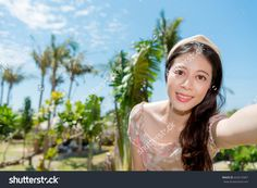 closeup photo of pretty attractive girl face to camera taking selfie picture and wearing dress travel.