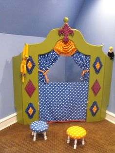 Puppet theater...I like the colors and design of this with the spectator stools...for storage purposes, make this out of fabric to hang on a tension rod in a doorway or hallway