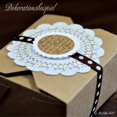 paper box with doily and ribbon