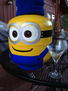 My project today- my hand-painted minion propane tank.