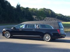 Platinum Phoenix-C hearse with full vinyl top.