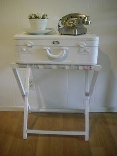 Painted suitcase and luggage rack turned into an adorable side table