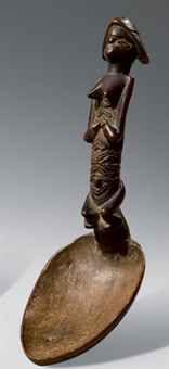 CUILLIERE BWENDE  République Démocratique du Congo  Superbe cuillère dont le manche représente un personnage au buste démesurément long. Les...