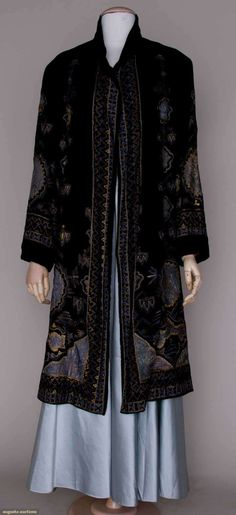 EMBROIDERED VELVET EVENING COAT, c.1925 Black silk velvet, blue silk appliques w/ metallic gold & silk floss tambour embroidery in Persian patterns, dull gold satin lining. Front