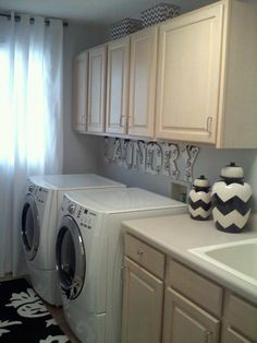 Lovely black and white laundry room!  Created with our Eva Damask Letters.  This would make laundry fun!