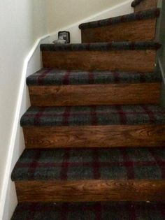 Wooden stairs with tartan carpet!