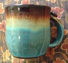 Large beautiful handmade ceramic wheel thrown mug in brown, turquoise and beige glaze